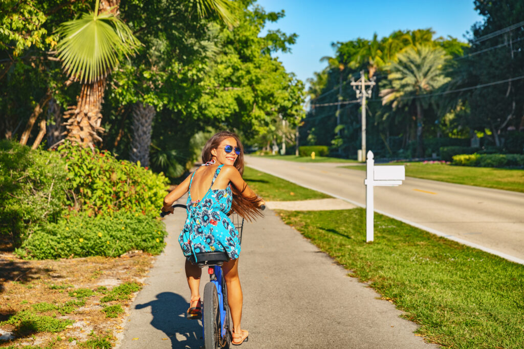 Girl riding bike in SouthWest Florida while on vacation